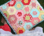 This hexagon pillow is precious; I really like the trim she used on the edge.  This will be made soon!