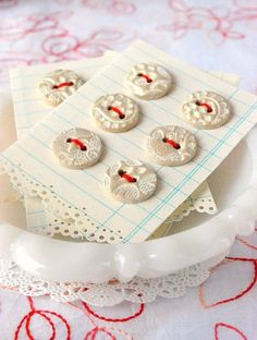 I have this lace stamp and old buttons! What  a great idea. Something like this would make a great gift!