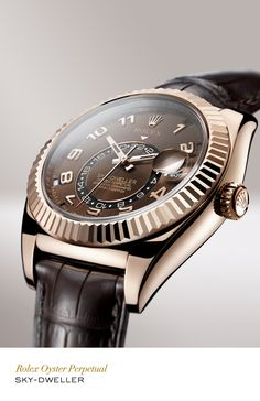 Rolex Sky-Dweller 42 mm in 18 ct Everose gold with a fluted bezel, chocolate dial and leather strap. #RolexOfficial