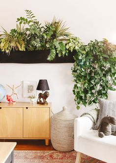 WallyGro in the playroom | via Yellow Brick Home Hanging Pots, Hanging Baskets, Faux Plants, Indoor Plants, Family Room Playroom, Family Rooms, Craft Room Lighting, Living Wall Planter, Dress Up Stations