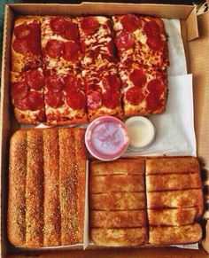 Pizza, bread sticks and cinnamon sticks