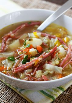 Corned Beef and Cabbage Soup - - Cabbage, potatoes, bell pepper and aromatics simmered on the stove with corned beef create this wonderful one pot meal. A fun twist on a Classic Irish dish!   I thought this was a great way to enjoy corned beef and incorporating lots of vegetables.