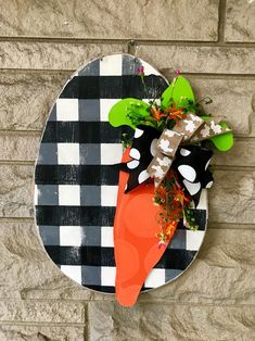 This buffalo Easter egg door hanger with carrot is made from wood. Painted with a black buffalo plaid and distressed. Carrot has tone on tone dots! Our signature greenery and ribbon mix adds the perfect touch, making sure you will have the best dressed do Easter Art, Hoppy Easter, Easter Crafts, Easter Eggs, Easter Decor, Easter Ideas, Easter Projects, Easter Bunny, Spring Crafts