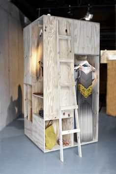 Plywood is used to create a simple but effective display for clothing