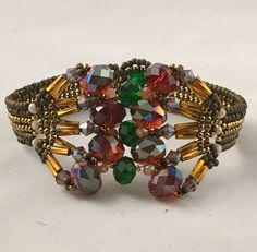 A personal favorite from my Etsy shop https://www.etsy.com/listing/575319677/handmade-bracelet-red-cooper-gold-purple