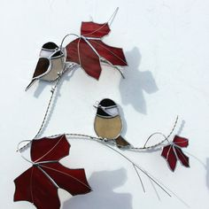 Chickadee stained glass suncatcher , bird on a 3 dimentional wire branch adorned with red maple leaves.