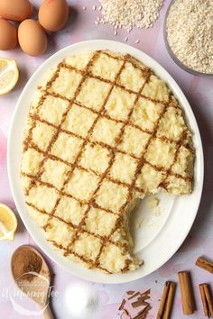 Arroz Doce (Portuguese rice pudding) on a large, white, oval-shaped plate. The rice pudding is decorated with ground cinnamon in a crosshatch pattern. A spoon rests on the plate where some of the pudding has been taken away. Creamiest Rice Pudding Recipe, Homemade Rice Pudding, Creamy Rice Pudding, Pudding Recipes, Portuguese Rice, Portuguese Desserts, Portuguese Recipes, Portuguese Sweet Rice Recipe, Rice Recipes For Dinner