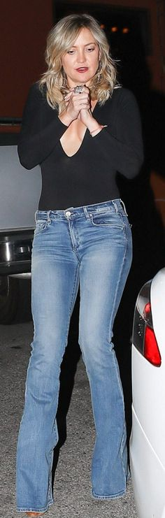 Who made Kate Hudson's black plunge bodysuit and flared jeans?