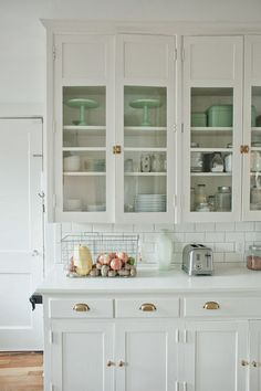 GLASS FRONT CABINETS IN KITCHEN BEAUTIFULLY DISPLAYED Design by Jami Nato (via from the nato's: kitchen renovation before and after)