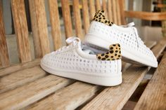 Loeffler Randall   white perforated leather sneaker with a pop of cheetah print