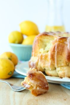 Lemon Monkey Bread: soft bun dough coated in lemon sugar, baked together and covered in a sweet and tangy lemon glaze. And you can make it ahead! www.thereciperebel.com