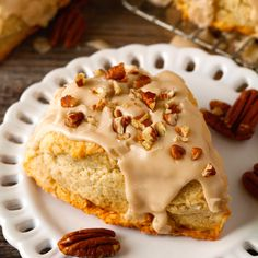 Maple Nut Scones Recipe Breakfast and Brunch, Breads, Afternoon Tea with all-purpose flour, baking powder, brown sugar, salt, heavy cream, large eggs, vanilla extract, unsalted butter, confectioners sugar, heavy cream, maple syrup, vanilla extract, pecans