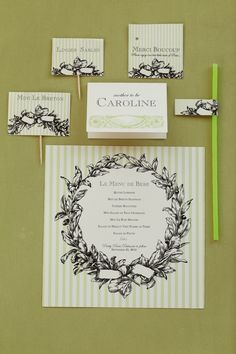 """That certain """"je ne sais quoi"""" of French culture is showcased in elegant menus, place cards, food flags, favor tags and thank you notes."""