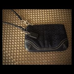 Black Coach Signature Wristlet Great condition - used once. Measures 6.5 x 4 inches. Coach Bags Clutches & Wristlets