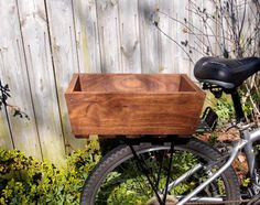 cool wooden bike but what really interests me is the placement of this box...neat idea for a flower box on the back of my garden bike. ;)