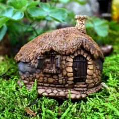 Thatched Roof Fairy House www.teeliesfairygarden.com A lovely thatched roof house that the gnomes would love to have as a home! #fairyhouse