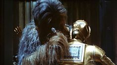 Chewie repairers C3PO and to his own amusement puts his head on back to front.