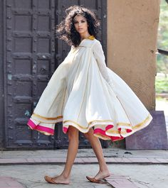 This breathtaking dual layered mulmul dress is crafted in cotton fabric. Multiple panels are finely finished with intricate gota work to give it a beautifu Pakistani Dresses, Indian Dresses, Indian Outfits, Cotton Dress Indian, Designer Kurtis, Designer Dresses, Kurta Designs, Blouse Designs, Cotton Dresses Online