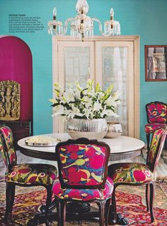 VINTAGE CHARM In the drawing room, an antique Hyderabadi chandelier hangs over colonial-styled furniture. The rug beneath the table is Persian. In the background, a fuchsia-coloured alcove holds a rare stone statue of Surya, the Hindu sun deity. Anita Lal's gorgeous New Delhi home featured in November's #ArchitecturalDigest India magazine.