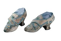 Pair of woman's shoes, second half 18th century. Cream silk brocade wowen with a design of floral motifs in blue and green, pale blue silk ribbon; ponted toe.