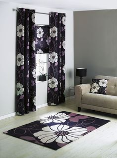 A gorgeous poppy pattern brings these full-length curtains from Argos to life. The large botanical print is offset with a stylish black background and silver ringtop.