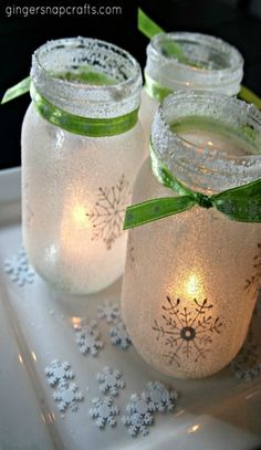 Mason jars, salt, tea lights and ribbon and you have a stunning luminary project for the holidays. These will brighten up any Christmas! Visit our 100 Days of Debt Free DIY Holiday Ideas for more recipes, decorating ideas, crafts, homemade gift ideas holiday budget tips and much more!