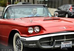 Looking cool: Joe Jonas took a spin in a 1960 Ford Thunderbird convertible with a male fri...
