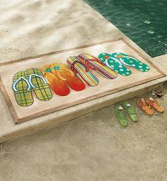 Ensure dirt and sand remain on deck with this whimsical Flip-flop Mat from Liora Manné.