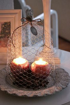 Re purposed chicken wire for candles Things To Make With Chicken, Bougie Candle, Chicken Wire Crafts, Making Baskets, Candle Magic, Wire Baskets, Nature Decor, Candle Lanterns, Fall Decor