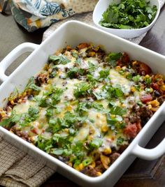 Mexican Casserole with layers of beans, corn, tomatoes, and ground beef. No one will know it's lighter!