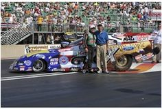 John Force and Bill Bader Jr. unveil The American Pride Funny Car that Force races at Auto-Plus Night Under Fire. Don't miss out - come to Summit Motorsports Park tomorrow & enjoy a night of fire and fun!! http://summitmotorsportspark.com/PrintNews.aspx?NewsId=960=The%2035th%20Annual%20Auto%20Plus%20Night%20Under%20Fire%20sizzles%20on%20Saturday,%20August%2011.