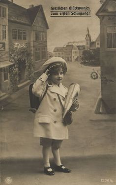 German girl on her first schoolday.  This is still the custom nowadays, only the cone of sweets is bigger than that one!