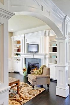 I like the trim around the built in bookshelves and the arch is lovely JD Bergevin Homes, Inc.'s Design, Pictures, Remodel, Decor and Ideas - page 4 Interior Columns, Interior Trim, Interior Design, Interior Paint, Style At Home, Living Room Designs, Living Spaces, Moldings And Trim, Crown Molding