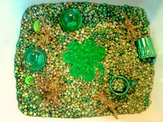 St Patrick's Day sensory tub-- I like the idea of having one color per tub to help learn colors