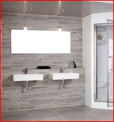 built out wall / ledge where sinks are mounted