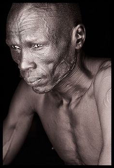 Nuer man, thinking (contemplative)