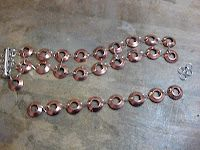 copper washer bracelet tutorial....Thinking I could use this and make a small chandelier mixed with crystals for my baby's room