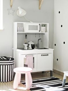 Scandi kids room playing corner with the lovely mini kitchen from IKEA