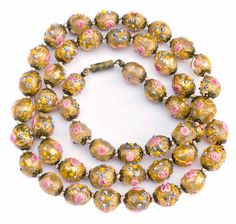 Rare long antique Venetian lampwork bead necklace in lovely condition. The necklace measures 26 5/8 inches in length. It is hand knotted between each bead with pink silk cord and ready to wear. The beads are approximately 10 mm in diameter. $269.