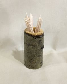 Handmade aspen toothpick holder.  Measuring approx. 3 inches tall, 1.5 inch diameter.  All of my aspen products come from a rapid regrowth renewable resource. I selectively thin small stands of trees on my property. Mostly 5 in diameter or less. I leave all old growth trees alone.  Aspen bark can come in a wide variety of coloration. From white/grey to various brown tones and multiple shades of green as well as nearly black. Many different colors can show up on the same finished product....