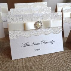 Lace place cards are a perfect addition to a classy wedding. Our pearl centerpiece accentuates the beauty of ivory, not to mention it matches with almost everything.  See more here: http://etsy.me/1Bsqxfh