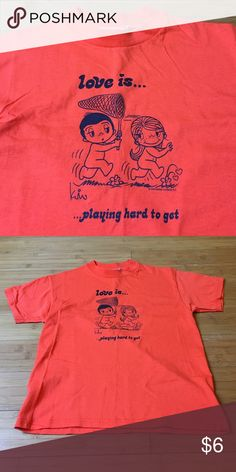 "Cute ""Love is..."" Shirt ☺️ Excellent condition with adorable ""Love is... playing hard to get"" message.  The cartoon is playful and fun.  I believe it is 100% cotton.  Happy Poshing  Princess Tops"