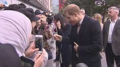 Meghan Markle gets a blessing of two older women: 'we wish you well' at Millennium Point in Birmingham. In this footage you also see Prince Harry with a nervous sausage dog and a man telling him he's an arsenal fan, like Prince Harry.