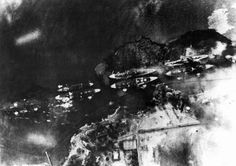 "An aerial view of ""Battleship Row"" at Pearl Harbor, photographed from a Japanese aircraft during the the bombing."