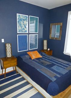 Young man's bedroom in Benjamin Moore Hale Navy walls with Japanese Boro textile bedspread. ~ Kimberley Heath Interior Design