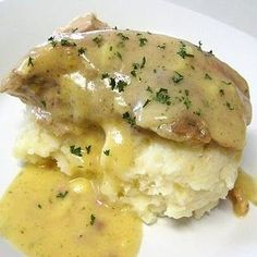 Ranch crock pot pork chops with parmesan mashed potatoes.