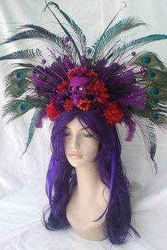 day of the dead headpiece orange and red flowers black feathers and peacock feathers purple skull rhinestone eyes sits on a headband very light weight