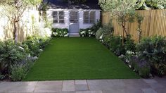 modern low maintenance garden design easy lawn grass painted fence great planting london (2)