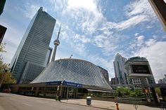 Roy Thomson Hall -- Opened in 1982, its circular architectural design exhibits a sloping and curvilinear glass exterior.