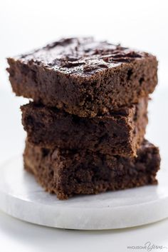 These easy, fudgy low carb brownies are made with almond butter and completely flourless. Naturally paleo, gluten-free